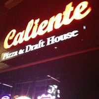 Photo taken at Caliente Pizza & Drafthouse by Eric O. on 8/9/2013