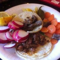 Photo taken at Tacos El Unico by Kelly V. on 5/10/2014