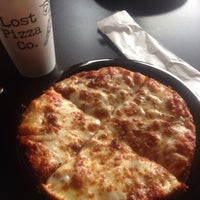 Photo taken at Lost Pizza Co. by Brad on 12/26/2014