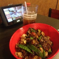 Photo taken at Genghis Grill by Brad on 11/10/2013