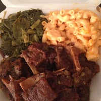 Photo taken at Gigi & Big R Caribbean Soul Food Cart by ShayLa P. on 2/6/2014