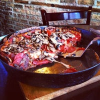 Photo taken at Pequod's Pizzeria by Angela W. on 6/27/2013