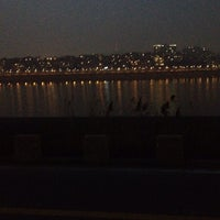 Photo taken at 동호대교 한강로 (Dongho Bridge, Hangang-ro) by Christine L. on 2/28/2014