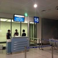 Photo taken at Gate 18 by Peerasak C. on 5/15/2013
