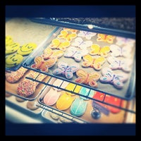 Photo taken at Mad Hatter Bakeshop & Café by Audra W. on 4/5/2013