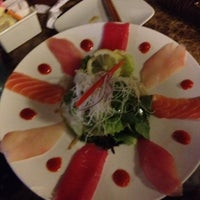 Photo taken at Sumo Sushi by Y K. on 9/23/2012