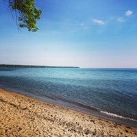 Photo taken at Big Bay Beach by Reggie W. on 6/7/2014