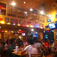Photo taken at Hooters by Celso M. on 3/3/2013