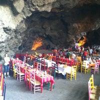 Photo taken at La Gruta Restaurant by Juan P. on 5/3/2013