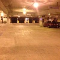 Photo taken at Henderson Parking Garage by Carl J. on 3/7/2016