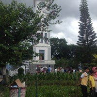 Photo taken at Jam Gadang by Maria W. on 12/25/2012