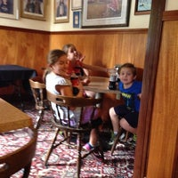 Photo taken at Famous Pizza by Scott M. on 9/21/2013