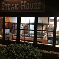 Photo taken at Trailhead steakhouse by Daniel H. on 3/10/2014