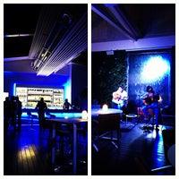 Photo taken at The Ritz-Carlton Bleu Lounge & Grill by Danah T. on 10/26/2012