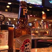 Photo taken at Smokey Bones Bar & Fire Grill by Esteban U. on 12/8/2013