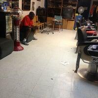 Photo taken at Kayo's Barber Shop by em h. on 9/12/2013