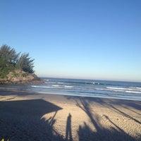Photo taken at Praia da Ferrugem by Persio D. on 7/17/2013