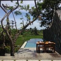 Photo taken at Ubud Padi Villa by Mark W. on 12/29/2013