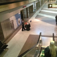 Photo taken at Denver International Airport Train by Mike M. on 12/17/2012