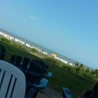 Photo taken at Bummz Beach Cafe by Tamara P. on 6/5/2014