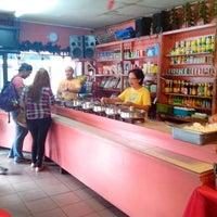 Photo taken at Minerva's by Joanne R. on 7/27/2013