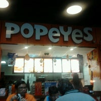 Photo taken at Popeyes by Mauricio F. on 1/1/2013