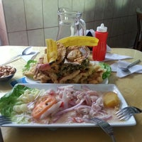 Photo taken at Cevicheria Geminis by Julio F. on 2/16/2013