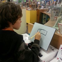 Photo taken at Page 1 Books by Dannie M. on 9/13/2013