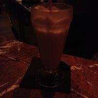 Photo taken at Mizu Asian Bistro + Bar by Dan N. on 12/28/2013