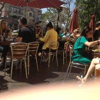 Photo taken at Coral Tree Café by Ryan B. on 3/24/2013