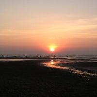 Photo taken at Ashwem Beach by darie on 12/15/2012