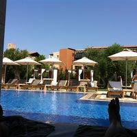 Photo taken at Romanos Costa Navarino Pool by Christina 🎀K💕 on 9/2/2013