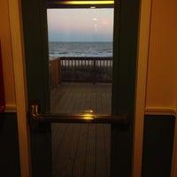 Photo taken at Ocean Village Hotel by Mark C. on 1/4/2014