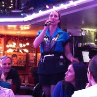 Photo taken at Ellen's Stardust Diner by Rebecca V. on 12/9/2012