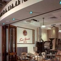 Photo taken at Honolulu Coffee Company by Yusri Echman on 12/8/2012