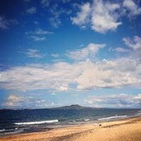 Photo taken at Mairangi Bay Beach by Stas K. on 3/29/2013