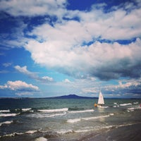 Photo taken at Mairangi Bay Beach by Stas K. on 3/31/2013