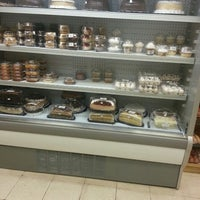 Photo taken at Grand Deli Gourmet by Moisés A. on 3/5/2013