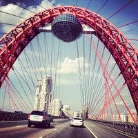 Photo taken at Zhivopisny Bridge by Natali B. on 6/8/2013