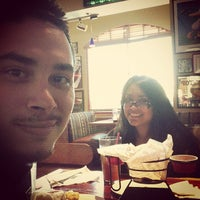 Photo taken at Red Robin Gourmet Burgers by Adrian L. on 5/13/2013