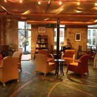 Photo taken at Ebenezers Coffeehouse by Laetitia B. on 3/11/2013