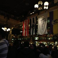 Photo taken at Fadó Irish Pub & Restaurant by Emily B. on 12/21/2012