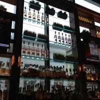 Photo taken at OneUP Restaurant & Lounge by Matt U. on 1/18/2013