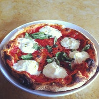 Photo taken at Olio Wood Fired Pizzeria by Kelly B. on 2/22/2013