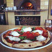 Photo taken at Olio Wood Fired Pizzeria by Kelly B. on 4/5/2013