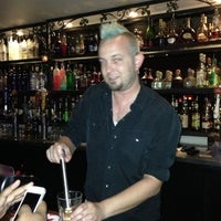 Photo taken at Esquire Bar & Martini Lounge by Pamela W. on 10/4/2012