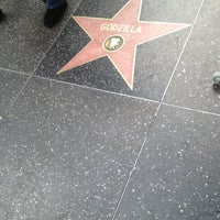 Photo taken at Godzilla's Star, Hollywood Walk of Fame by Thirsty J. on 12/30/2012