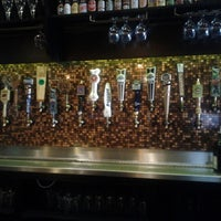 Photo taken at Flying Saucer Draught Emporium by Ian R. on 9/21/2012