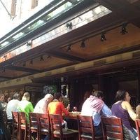 Photo taken at Joe's American Bar & Grill by Owen D. on 10/6/2012