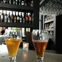 Photo taken at Purple Cafe & Wine Bar by Steven M. on 6/24/2013